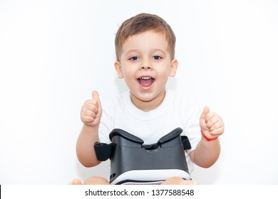 little boy with virtual reality glasses on a white background