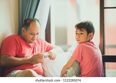 Little boy wait  to play with father while he busy on mobile