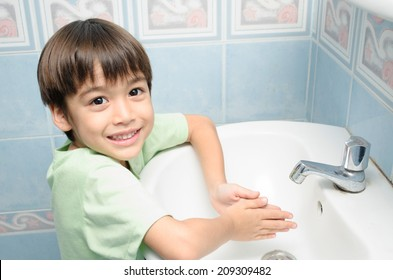 Little boy waiting for washing hand