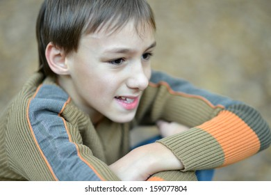 little boy in a warm sweater for a walk in the autumn