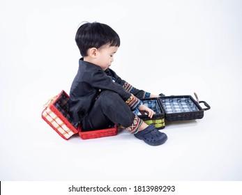 little boy wearing black native dress on white background