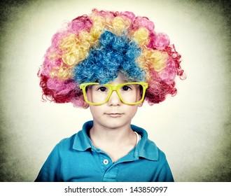 Little boy wearing clown wig in vintage technique
