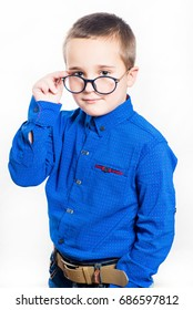 Little boy wearing eyeglasses on the white background