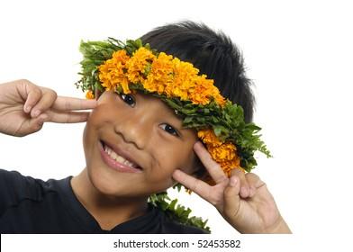 Little boy wearing a Hawaiian lei posing
