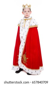 Little boy wearing red costume of a king. Isolated on white