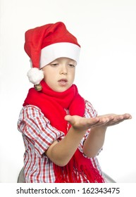 Little boy wearing Santa Claus