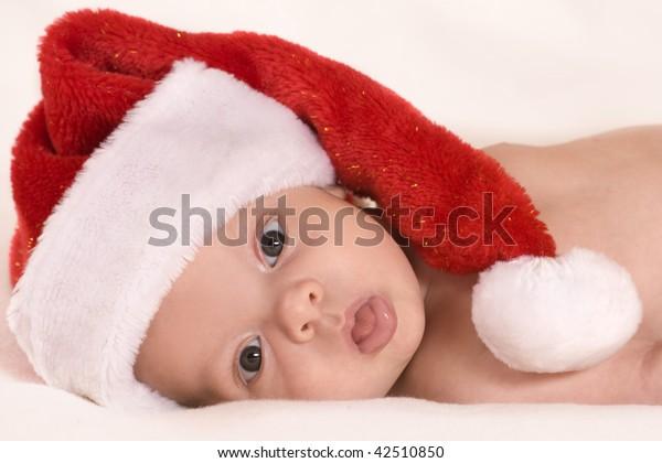 Little boy wearing a Santa hat