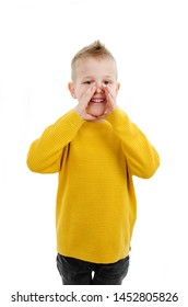 Little boy wearing yellow sweatshirt over isolated background hand on mouth telling secret rumor, whispering malicious talk conversation. Isolated on white background