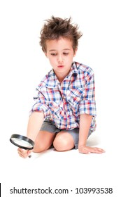 Little boy with weird hair researching using magnifier  isolated on white