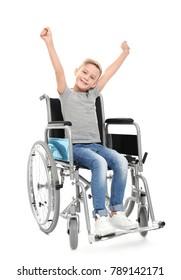 Little boy in wheelchair on white background