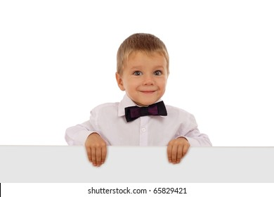 Little boy in white shirt with an empty banner, isolated on white