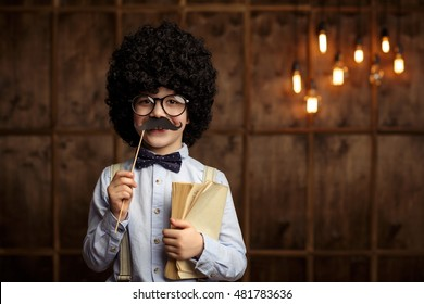 Little boy with wig in studio