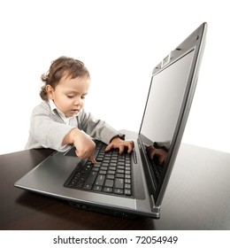 little boy works on laptop isolated on white