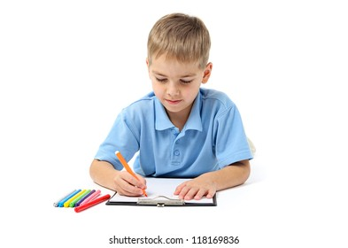 Little boy writing with pencils on white background