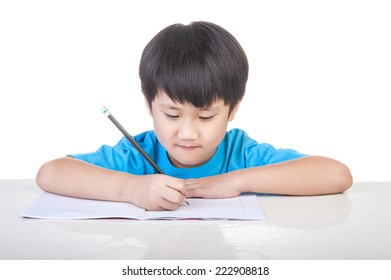 Little boy writing white paper on the table