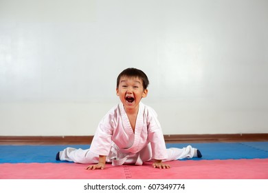 Little boy yells a battle cryFighting position, active lifestyle, practicing fighting techniques