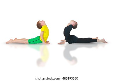 little boy and yoga doing yoga on white background