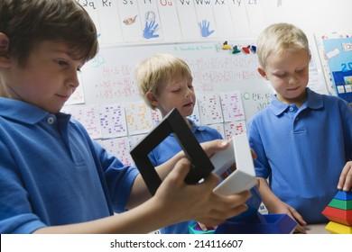 Little Boys Assembling Toys Pieces