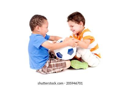 little boys fighting over soccer ball isolated in white