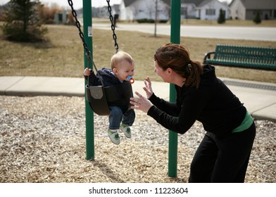 Little boy's first swing with mommy