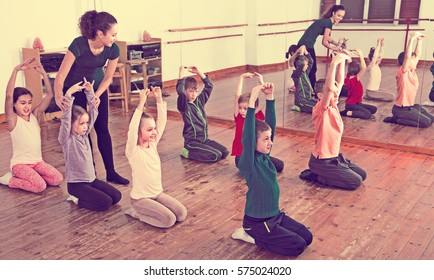 Little boys and girls studying contemp dance in junior class