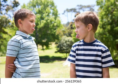 Little boys having a fight on a sunny day