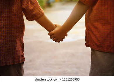 little boys holding hands. friendship and love concept. two boys student holding hands and walking together