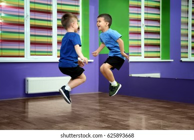 Little boys jumping in choreography class