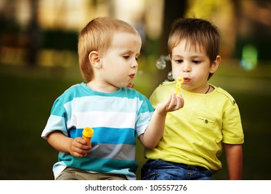 little boys playing with bubbles