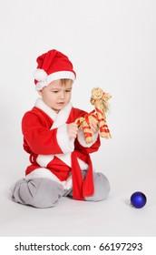 little boys in Santa clothes sitting