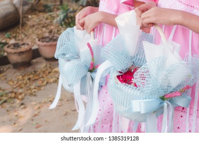 Little bridesmaid girl holding with a basket of rose petals at the wedding ceremony.