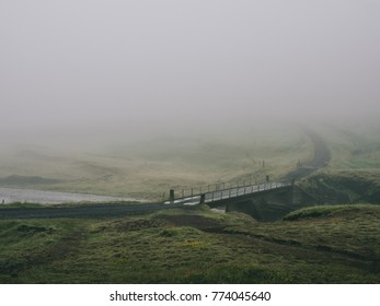 little bridge over icelandic river at cloudy day in Iceland