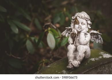 little broken angel at cemetery