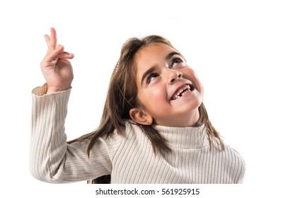 Little brunette girl pointing up