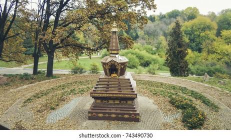 Little Buddha statue in autumn park
