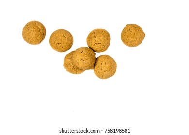 Little Bunch of scattered Pepernoten cookies from above as Sinterklaas decoration on white background for dutch sinterklaasfeest holiday event on december 5th