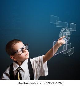 Little business boy pressing digital button