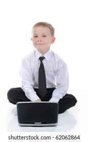 Little businessman with a laptop sitting on the floor. Isolated on white background
