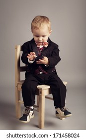 little businessman with mobile phone