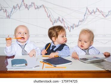 Little businessman portrait in office