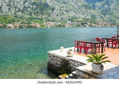 A little cafe in Kotor with a view on Bay of Kotor , Montenegro