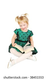 Little Caucasian blond girl sitting and reading a book isolated on the white.