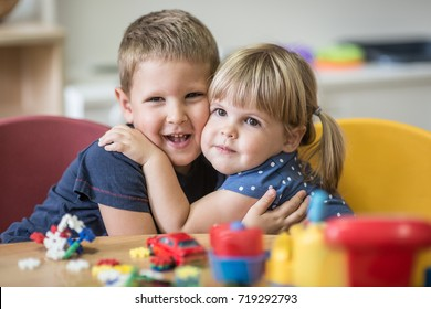 Little caucasian blonde brother and sister hugged