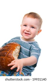 A little Caucasian boy eating a bread.isolated on a white background.