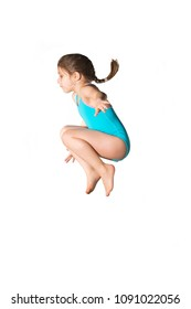 Little caucasian female 7 years old girl in cyan swimming costume jumping on white background. Summertime, sport, springboard diving and ricreation concept.