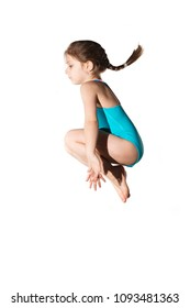 Little caucasian female 7 years old girl in cyan swimming costume jumping on white background. Summertime, sport and recreation concept.