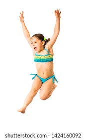 Little caucasian female 8 years old girl in cyan multicoloured swimmwear jumping on white background. Summertime, sport and recreation concept.