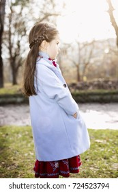 little caucasian girl at  autumn afternoon