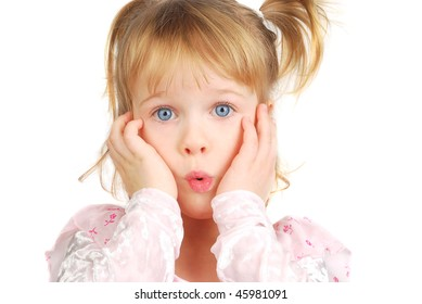 Little Caucasian girl with blue eyes in pink dress with very confused, surprise or different facial expression. She making funny very emotional face and hold cheeks for arm.