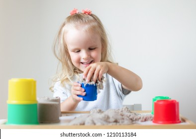 Little Caucasian Girl Playing with Kinetic Sand at Home Early Education Preparing for School Development Children Game